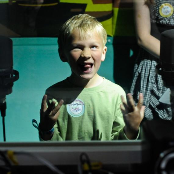 Boy in front of microphones